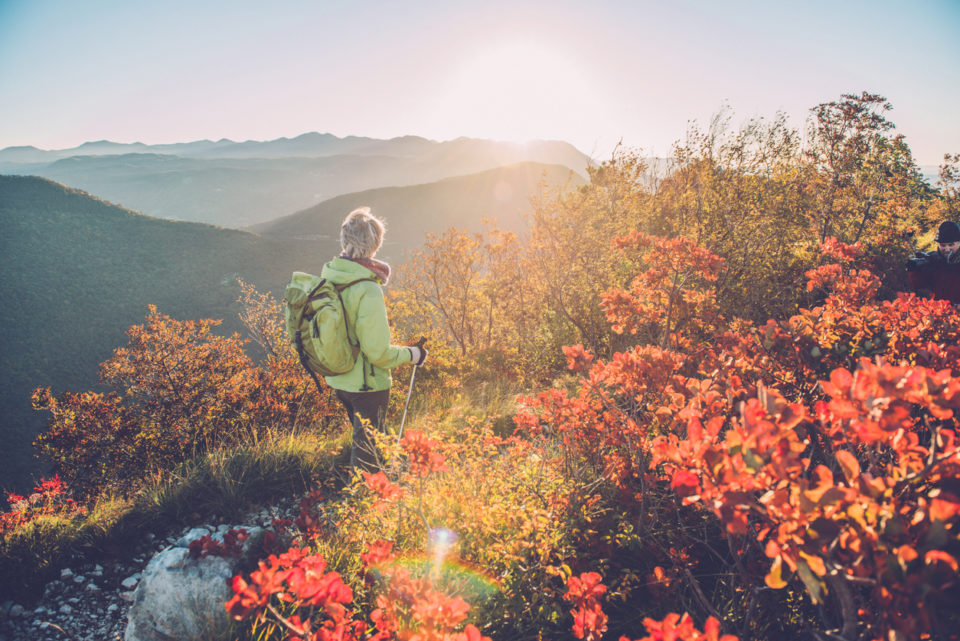 Senior woman hiking on the mount